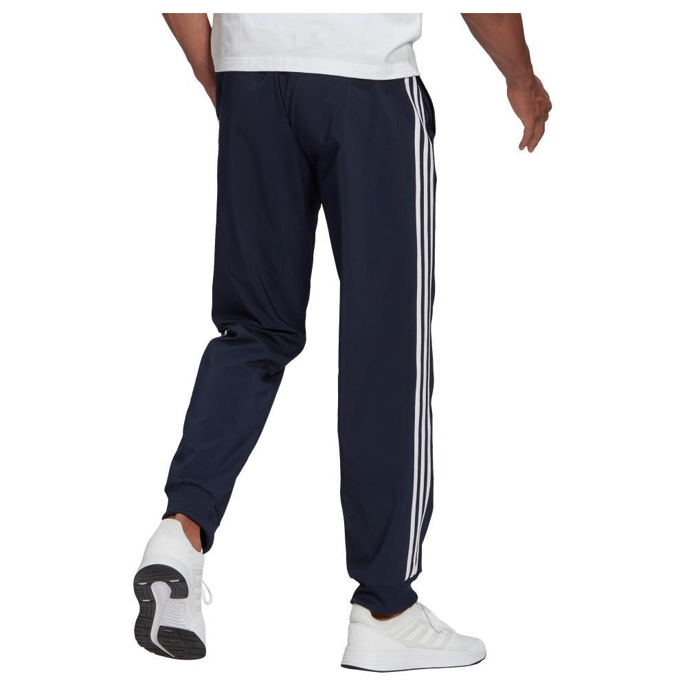 Pantalón De Buzo Hombre Adidas Eroready Essentials Tapered Cuff Woven 3 Bandas image number 1.0