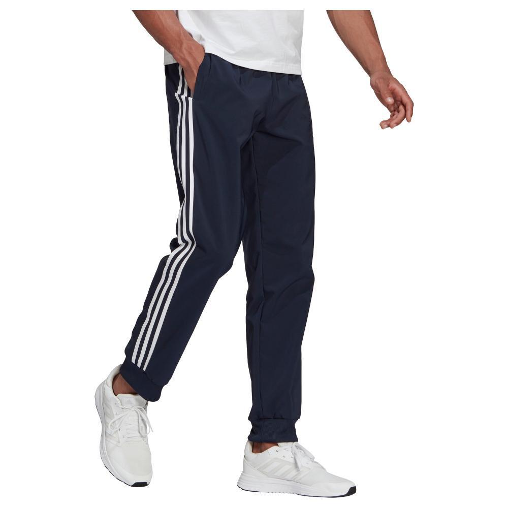 Pantalón De Buzo Hombre Adidas Eroready Essentials Tapered Cuff Woven 3 Bandas image number 0.0